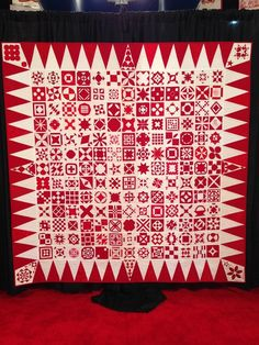 Red and white Dear Jane quilt at the 2014 Houston International Quilt Festival.  Photo by SewCanShe