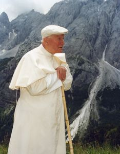 Pope John Paul II, walking stick in hand, strolls near the Dolomite Alps in northern Italy in the summer of 1996. He was 76 then. The pontiff continued to persevere to the limits of his personal strength, despite having been diagnosed with a disease like Parkinson's in the mid-1990s.