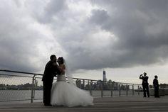 Hurricane Sandy wedding  Love her dress.  Love conquers all...even a Frankenstorm