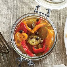 Pickled Peppers | We used sweet mini bell peppers and jalapeños, but any variety like serranos, Fresno, Thai, or poblano peppers will also work well. | SouthernLiving.com