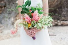 tropical bouquet in this Dreamy Beach Vow Renewal in Saipan | Mylyn Wood Photography on Oh Lovely Day