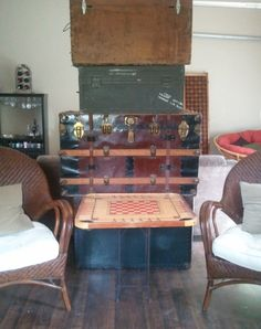 Family stacked trunks with our carom board table.