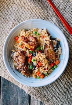 Ribs and Rice is an awesome one pot meal that's one of many great rice cooker recipes. The flavors of pork ribs, shiitake mushrooms, and vegetables infuse into the rice.
