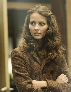 Amy Acker - she is so pretty. I LOVE her hair here. I had my hair that long, or a little longer, at one point and loved it.