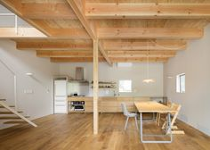 House in Mikage contrasts white surfaces with exposed wooden beams
