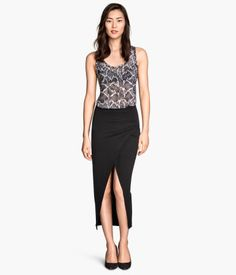 Although this picture is showing a black skirt it is also available in grey wrap front skirt for Mom to wear. Would pair this with any of the blouses shown.