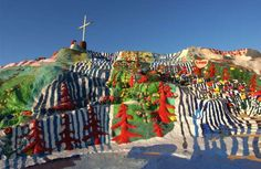 Salvation Mountain - California, United States: This workmanship establishment covers a slope north of Calipatria, California, not a long way from the Salton Sea. It is produced using adobe, straw and a huge number of gallons of paint. It was made by neighborhood occupant Leonard Knight and components various #WallPaintings and zones painted with Christian platitudes and Bible verses.