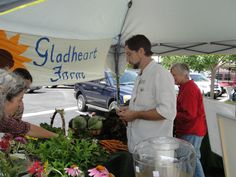 Hilton Asheville - Sous Chef Joe shops the Farmer's Market at Biltmore Park Town Square for ingredients to use in Roux's weekly specials.