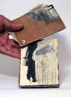 Linda Welch....  I can see using this type of attachment when making a deck of cards into a journal.....