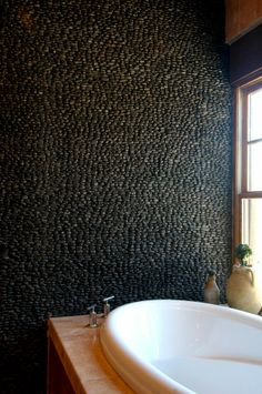 Texture- Standing black pebble tiles are perfect bathroom walls.
