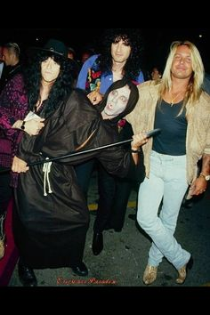 holy shit Vince Neil is in this pic With Eric Carr and Bruce Is Eric wearing a witch hat? LOL