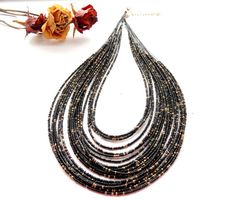 https://www.etsy.com/listing/265537065/seed-bead-necklace-strand-necklace?ref=listing-shop-header-1
