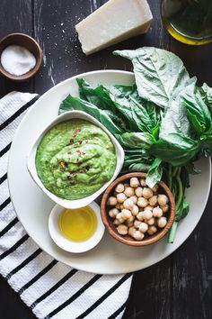 Nut-Free Chickpea Basil Pesto recipe using garbanzo beans instead of pine nuts. 5 minutes, 5 ingredients, and great on pasta, pizza, and veggies. Real Food Recipes, Vegetarian Recipes, Healthy Recipes, Clam Recipes, Herb Recipes, Chickpea Recipes, Dishes Recipes, Vegan Soups, Vegan Dishes