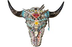 A custom bison skull that I decorated for my personal home! There are so many amazing treasures piled on this skull....quartz, turquoise, Kuchi Tribe patches, feathers, mexican jewelry, roses, copper, Huichol beads and more! I just love this piece.