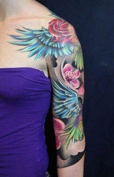 http://tattoomagz.com/purple-tattoos/shoulder-and-rose-purple-tattoo/