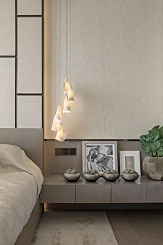 Charming grey bedroom design with beautiful pendant lamps by kelly hoppen