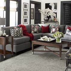 Finally, a beautiful living room that isn't BEIGE!!! Love the color scheme.