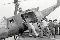 America's Tragic 'Last Days in Vietnam' — Sailors on the destroyer USS Kirk push helicopters into the ocean to make room for more helicopters and refugees.