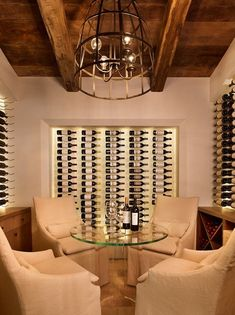 "Comfy linen chairs to ""warm up"" a chilly wine room."