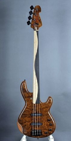 Nice swirl pattern on the fretboard on this bass. #DdO:) - BASSes OF LIFE: Just wish the designer had been more of an artist and went with the natural tan and brown wood tones... including for the fake looking violin rest on bottom edge.