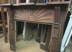 Antique Arts and Craft sunburst mantel.