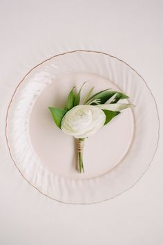 Dress your man in style with a simple and chic boutonniere.   - HarpersBAZAAR.com