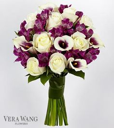 This will be Amariz's bouquet. She had said that she wanted either purple or turquoise to be one of her main colors, but unfortunately, real flowers don't come in bright turquoise so I went with purple. This bouquet is made up of white roses, purple Peruvian lilies, and Picasso (purple and white) calla lilies. It is by Vera Wang and the stems will be wrapped in silver ribbon instead of greenery.