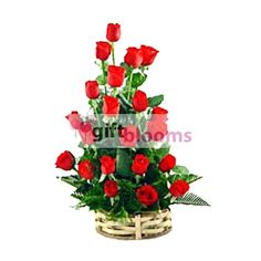 Beautiful Basket Of 24 Red Roses For your loved one in Saudi Arabia.
