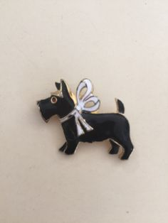 A personal favorite from my Etsy shop https://www.etsy.com/listing/456978208/vintage-enamel-scotty-brooch-pin-animal