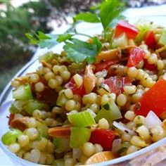 Light Mediterranean flavors of toasted almonds and lemon peel flavor this cold pasta salad that features Israeli (pearl) couscous.