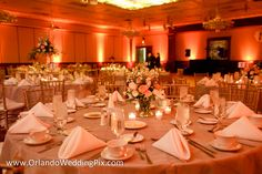 salmon and beige wedding cakes | Soft Salmon up-lighting created extra pops of pink throughout the ...