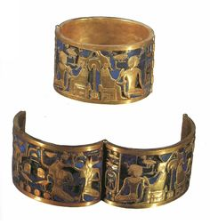 This piece is a bracelette that belonged to Queen Ahhotep, Egyptian Museum, Cairo It is gold over a lapis lazuli background and was found in her tomb along with other treasures. This bracelet depicts the god Geb - representing the earth - wearing both crowns of Egypt and givinghis blessings to the kneeling king.