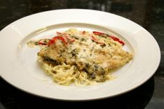 Use chicken breasts, thin cutlets, or tenders in this easy skillet chicken recipe. The chicken is cooked with a creamy garlic sauce and served with spaghetti or angel hair pasta.