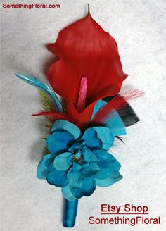 Red, mini calla lily and turquoise delphinium boutonniere with teal satin stem wrap and red, turquoise, and black feather accents. #red #aqua #turquoise #teal #wedding #flowers #boutonniere #buttonhole #prom #homecoming #groom #feathers #feather #black