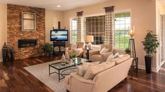 Open family room with stone fireplace