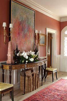 I'm loving the terracotta paint color, some of my favorites are Sherwin Williams Wheat Penny and Clay Pot, Hall with great art