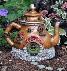 A fairy house teapot!  Love it!