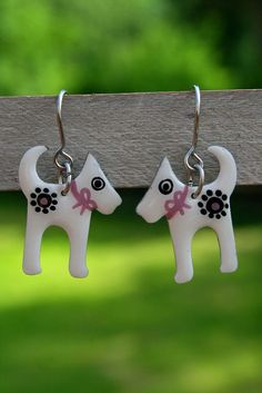 Fun Dog Earrings by CinkyLinky  The Adorable White Dog Earrings are the original gift idea for a dog lover. These cute handpainted earrings are set in enameled Stainless Steel base and covered with high quality resin finish for their best protection. You will love their delicate design.  Crafted with a unique combination of artisan techniques, these dog earrings will add cheer to your day. A beautiful gift to make someone special smile.  #cinkylinky #dogearrings