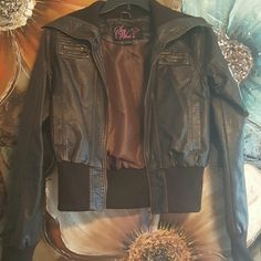 Brown Bomber Jacket Super cute Bomber Jacket. Will fit size 5/7.   Body of the jacket is 60% polyester blend 40% cotton lining is 100% polyester Jackets & Coats