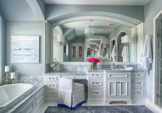 Many, many great ideas on this page...Gray bathroom with white cabinets. Studio M Interiors. High sink, lower knee space. Pretty gray marble.