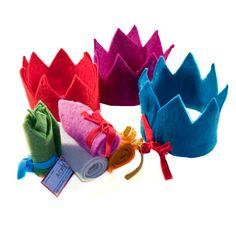 adjustable felt crown.  if they were in a light fabric, then the kids could decorate them with fabric markers and felt stickers.