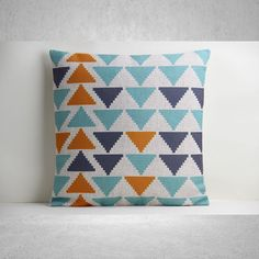 An eye-catching addition to your sofa or kitchen bench, this cotton and linen blend cushion cover features a vibrant geometric design.
