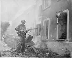 German Officer surrenders to a US soldier, armed with a BAR.