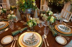 Each table setting features an ornamental kale. Using food as decor is one of Westbrook's signature touches when he's decorating a dining space; he recommends personalizing each setting with an individual piece of fruit.    Dinner and bread plates: 5486, Moritake, circa 1940s, Garden Court Antiques; salad plates: Christmas Tree, Williams-Sonoma; hurricane candle lamps: Raj, Crate & Barrel.