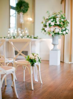 wedding ceremony decor | pretty floral chair detail | I like that it's tied by the seat and not at the top, also the pretty hanging ribbon detail