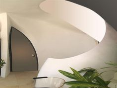 "Biomorphic house. ""This style is inspired by organic shapes, adopting the use of curves and flow into the building, with few or no straight lines."" http://terence2349.wordpress.com/2012/12/11/biomorphic-architecture/"