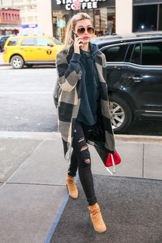 Hailey Baldwin wearing Saint Laurent Blake Low-Heel Suede Ankle-Strap Booties, RTA Jagger Jeans in Exploded Black, Saint Laurent Small Rive Gauche Colorblock Satchel and Zara Checked Coat with Lapel