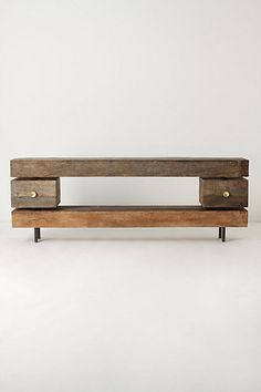 Ettore Console. Inspired by Italian-Modern design, this substantial two-drawer piece of unfinished, reclaimed wood stretches out in minimal sleekness.