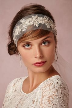 Lovely beaded appliques on simple soft bridal tulle. Inessa Tulle Sash from BHLDN