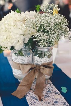 Tie together mason jars with a ribbon to create a center piece